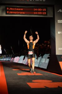 Life before myeloma. Me crossing the Ironman finishing line. Mission accomplished